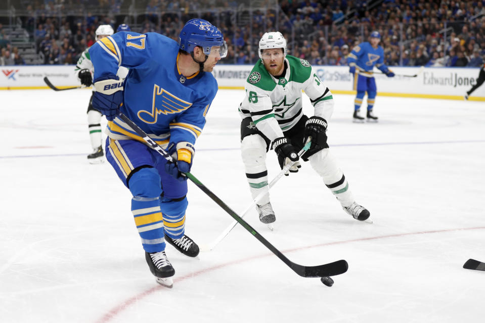 St. Louis Blues' Jaden Schwartz (17) handles the puck as Dallas Stars' Joe Pavelski (16) defends during the second period of an NHL hockey game Saturday, Feb. 8, 2020, in St. Louis. (AP Photo/Jeff Roberson)