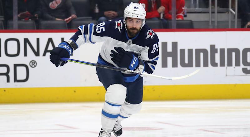 DETROIT, MICHIGAN - DECEMBER 12: Mathieu Perreault #85 of the Winnipeg Jets skates against the Detroit Red Wings at Little Caesars Arena on December 12, 2019 in Detroit, Michigan. (Photo by Gregory Shamus/Getty Images)