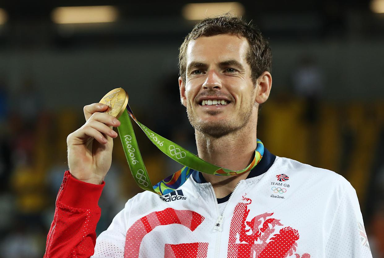 RIO DE JANEIRO, BRAZIL - AUGUST 14:  Andy Murray of Great Britain poses with his Gold medal after defeating Juan Martin del Potro of Argentina in the Men's singles final at Olympic Tennis Centre on August 14, 2016 in Rio de Janeiro, Brazil. (Photo by Ian MacNicol/Getty Images)