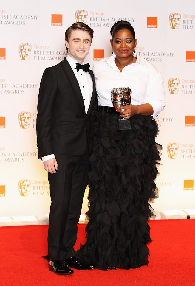 LONDON, ENGLAND - FEBRUARY 12:  Best Supporting Actress winner Octavia Spencer poses in the press room with actor Daniel Radcliffe during the Orange British Academy Film Awards 2012 at the Royal Opera House on February 12, 2012 in London, England.  (Photo by Chris Jackson/Getty Images)