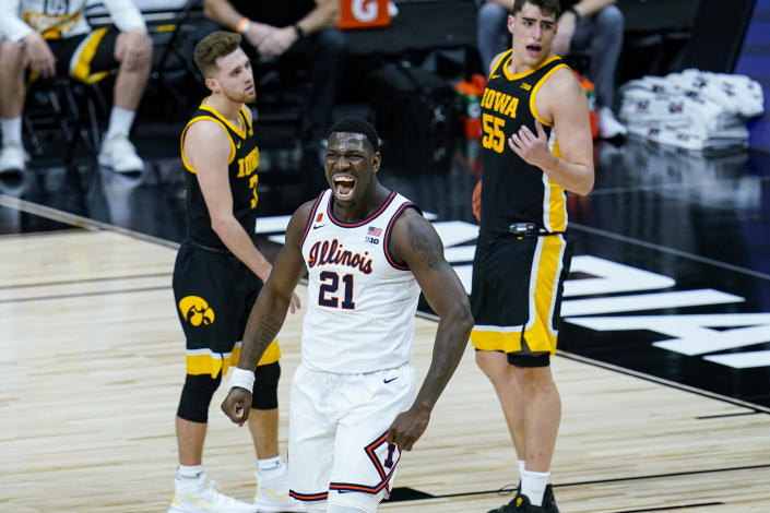 Illinois center Kofi Cockburn (21) celebrates after being fouled on a basket against Iowa in the first half of an NCAA college basketball game at the Big Ten Conference tournament in Indianapolis, Saturday, March 13, 2021. (AP Photo/Michael Conroy)
