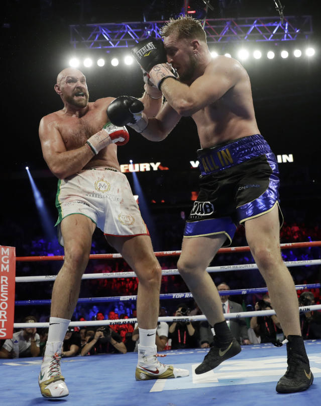 Tyson Fury, left, of England, fights Otto Wallin, of Sweden, during their heavyweight boxing match Saturday, Sept. 14, 2019, in Las Vegas. (AP Photo/Isaac Brekken)