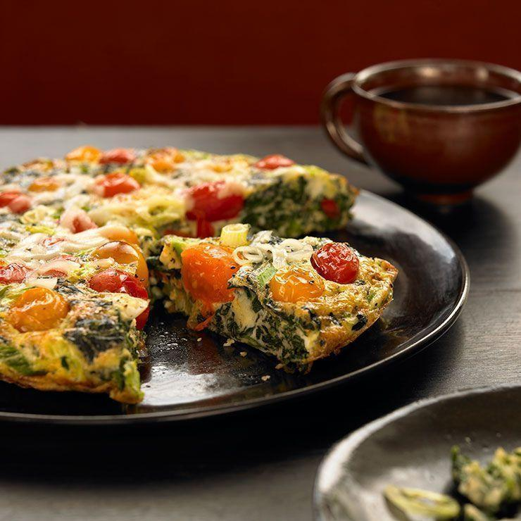 """<p>Putting a warm meal on the table doesn't have to mean hours of prep—this veggie-filled frittata comes together in only 15 minutes. We love it as a hearty dinner, but this low-calorie recipe also ideal for chilly weekend mornings.</p><p><strong><em><a href=""""https://www.prevention.com/food-nutrition/a26987994/spinach-tomato-frittata-recipe/"""" rel=""""nofollow noopener"""" target=""""_blank"""" data-ylk=""""slk:Get the recipe »"""" class=""""link rapid-noclick-resp"""">Get the recipe »</a></em></strong></p>"""