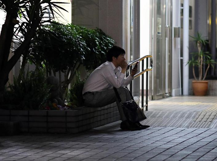 A Japanese government study found that 16% of full-time workers took no paid holidays in 2013, while others took just half their allotted vacation on average (AFP Photo/Yoshikazu Tsuno)