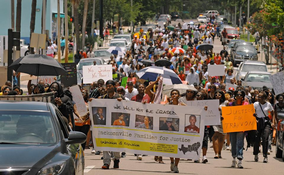 Protesters make their way down East Duval Street on the final leg of their protest march in Jacksonville, Fla. on Saturday, July 20, 2013. Several hundred protesters gathered to express a variety of grievances including the verdict in the George Zimmerman trial, the job being done by State Attorney Angela Corey and the sentence received by Marissa Alexander, a Jacksonville woman sentenced to 20 years after firing a warning shot with her gun and claiming self defense from her abusive husband. (AP Photo/The Florida Times-Union, Bob Self)