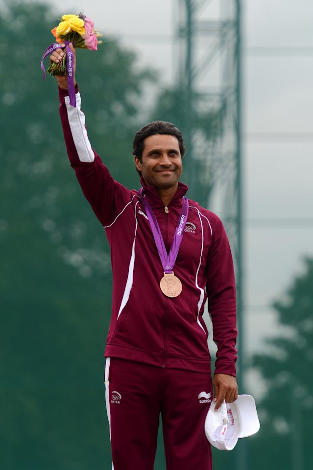 LONDON, ENGLAND - JULY 31:  Bronze medalist Nasser Al-Attiya of Qatar poses on the podium during the medal ceremony for the during the Men's Skeet Shooting final round on Day 4 of the London 2012 Olympic Games at The Royal Artillery Barracks on July 31, 2012 in London, England.  (Photo by Lars Baron/Getty Images)