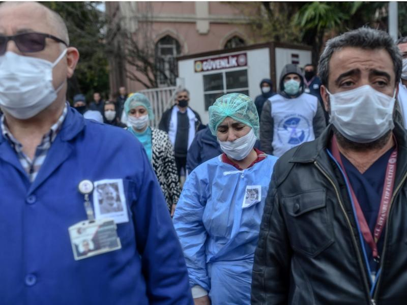 Health workers mourn outside Istanbul University Faculty of Medicine during a commemoration for professor Cemil Tascooglu, the country's first medical professional to pass away from COVID-19, on April 2.