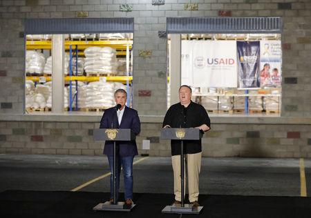 U.S. Secretary of State Mike Pompeo and Colombia's President Ivan Duque attend a news conference at a warehouse where international humanitarian aid for Venezuela is being stored, near La Unidad cross-border bridge between Colombia and Venezuela in Cucuta, Colombia April 14, 2019. REUTERS/Luisa Gonzalez