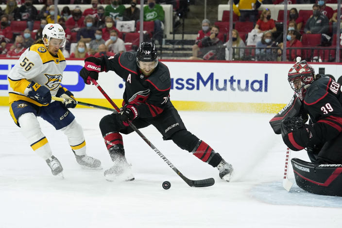 Carolina Hurricanes defenseman Jaccob Slavin (74) and goaltender Alex Nedeljkovic (39) defend the goal against Nashville Predators left wing Erik Haula (56) during the first period in Game 5 of an NHL hockey Stanley Cup first-round playoff series in Raleigh, N.C., Tuesday, May 25, 2021. (AP Photo/Gerry Broome)