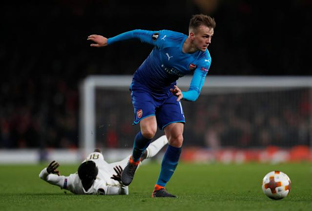 Soccer Football - Europa League Round of 32 Second Leg - Arsenal vs Ostersunds FK - Emirates Stadium, London, Britain - February 22, 2018 Arsenal's Rob Holding in action with Ostersunds FK's Frank Arhin Action Images via Reuters/Peter Cziborra