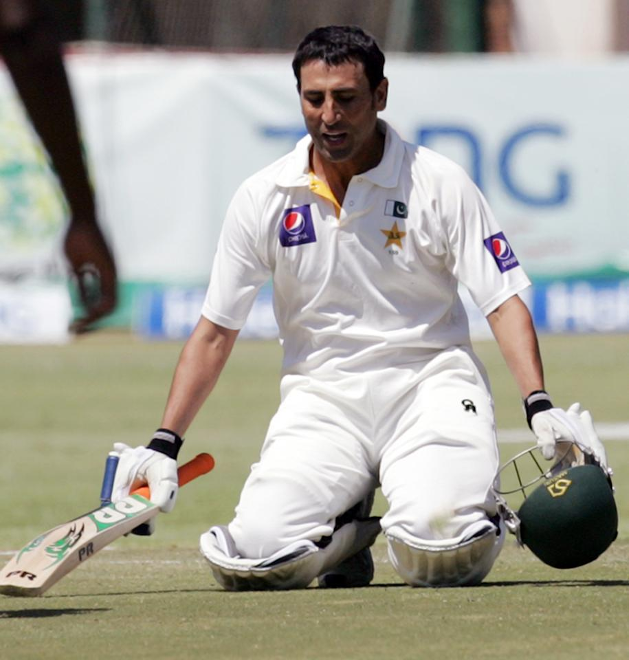 Pakistan's batsman Younis Khan celebrates his century (a score of 100 or more runs in a single innings) during the fourth day of the first cricket test match between Pakistan and hosts Zimbabwe at the Harare Sports Club September 6, 2013. AFP PHOTO / JEKESAI NJIKIZANA        (Photo credit should read JEKESAI NJIKIZANA/AFP/Getty Images)
