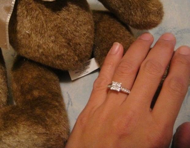 The diamond engagement ring was found in the parking lot of the KFC in Summerside. When Curtis Lynch proposed to his then-girlfriend, Sharon, in 2010, he hid it inside a teddy bear. (Sharon Lynch - image credit)