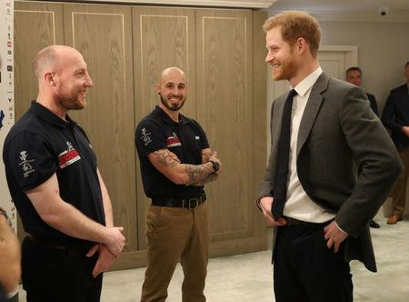 Britain's Prince Harry meets wounded veterans from the U.S and UK whom will walk 1,000 miles from the west to the east coast of America in 14 weeks at a launch in London