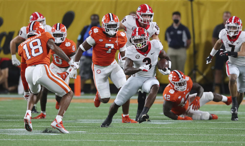 Georgia tailback Zamir White breaks loose for a long run against Clemson during the second half of an NCAA college football game Saturday, Sept. 4, 2021, in Charlotte, N.C. (Curtis Compton/Atlanta Journal-Constitution via AP)