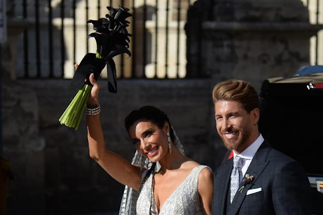 Pilar Rubio and Sergio Ramos waved to the crowd after marrying in Seville (AFP Photo/CRISTINA QUICLER)