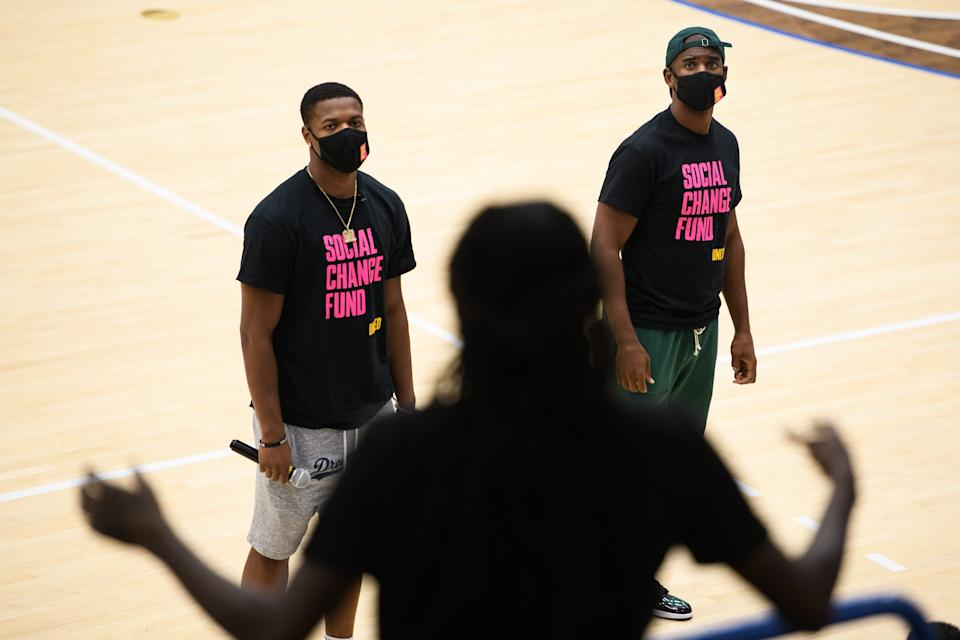 Rakeem Jones, center ask NBA players Dennis Smith Jr. and Chris Paul a question during a Q&A at Capel Arena on Fayetteville State University on Wednesday, Oct. 28, 2020. Paul is traveling the country going to historically black colleges to get people to vote in the upcoming election.