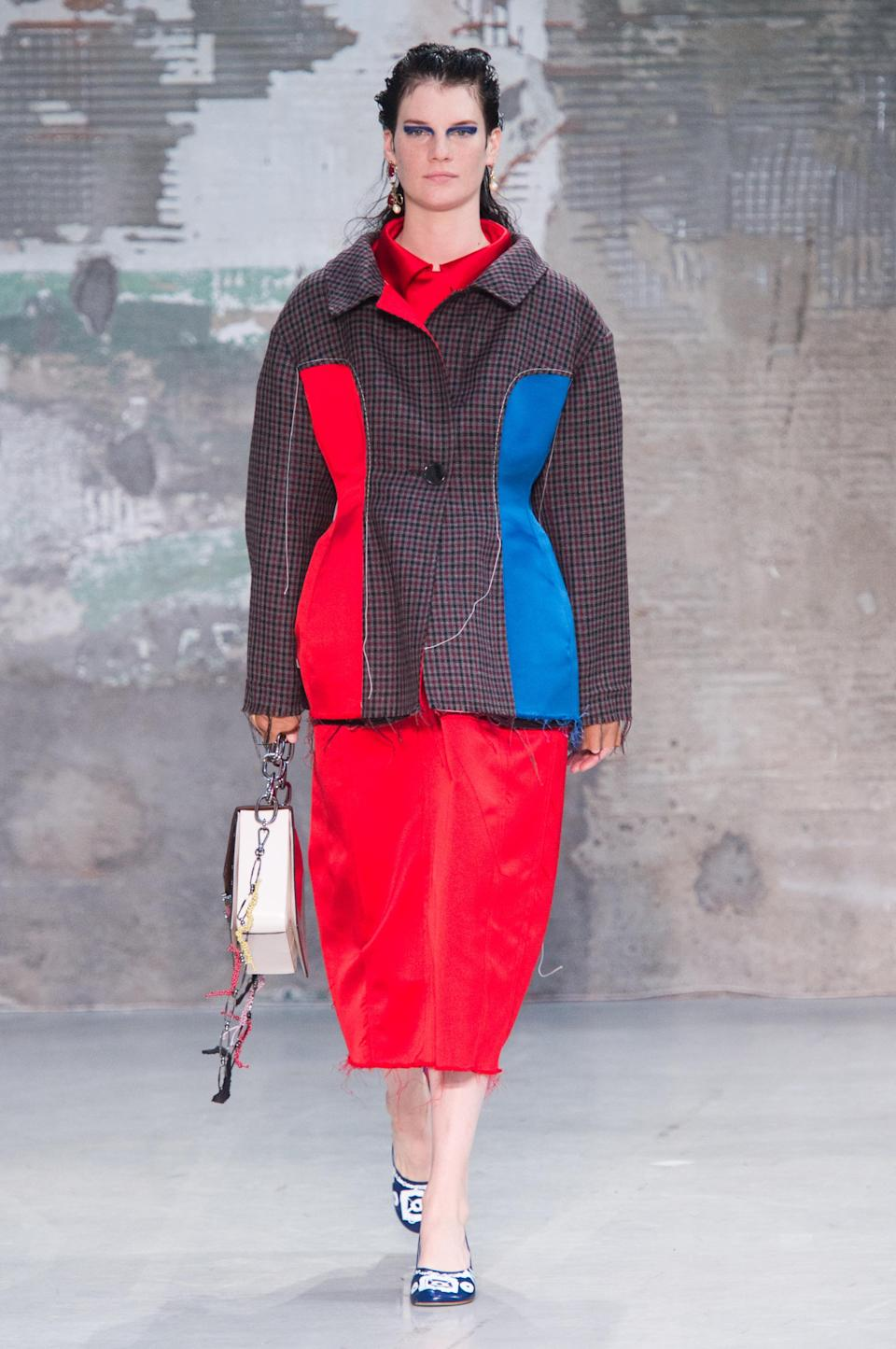 <p><i>Model wears a boxy red and blue panel jacket and collared dress from the SS18 Marni collection. (Photo: ImaxTree) </i></p>