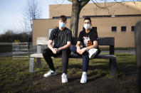 High school students Robin Reyer, left, and Mohammad Alshebli, 16 and 17 years old, pose for a photo at the Arche, or Ark, an organization that supports children, youth and families in the Hellersdorf neighbourhood, on the eastern outskirts of Berlin, Germany, Tuesday, Feb. 23, 2021. Since the outbreak of the coronavirus pandemic, the Arche has had to reduce their real face-to-face assistance or traditional classroom schooling as an offer for children, mainly from underprivileged families, drastically. Some kids are still allowed to come over in person, but only once every two weeks. (AP Photo/Markus Schreiber)