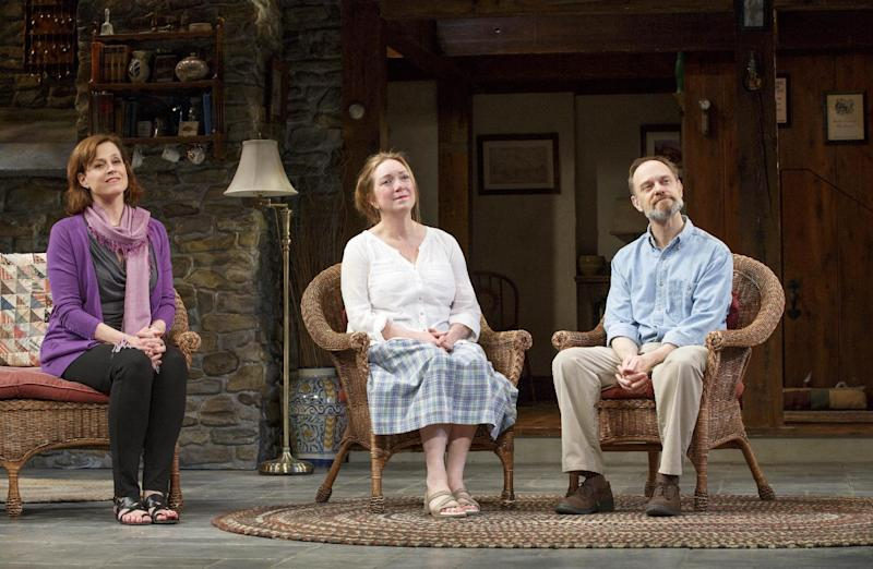 """This publicity photo provided by L-R: Sigourney Weaver, Kristine Nielsen, and David Hyde Pierce in """"Vanya and Sonia and Masha and Spike."""" All kinds of things are flipped around in the playwright, Christopher Durang's utterly refreshing farce """"Vanya and Sonia and Masha and Spike,"""" which has happily made the leap from off-Broadway to open Thursday, March 14, 2013,  at the Golden Theatre. (AP Photo/O and M Co., Carol Rosegg)"""