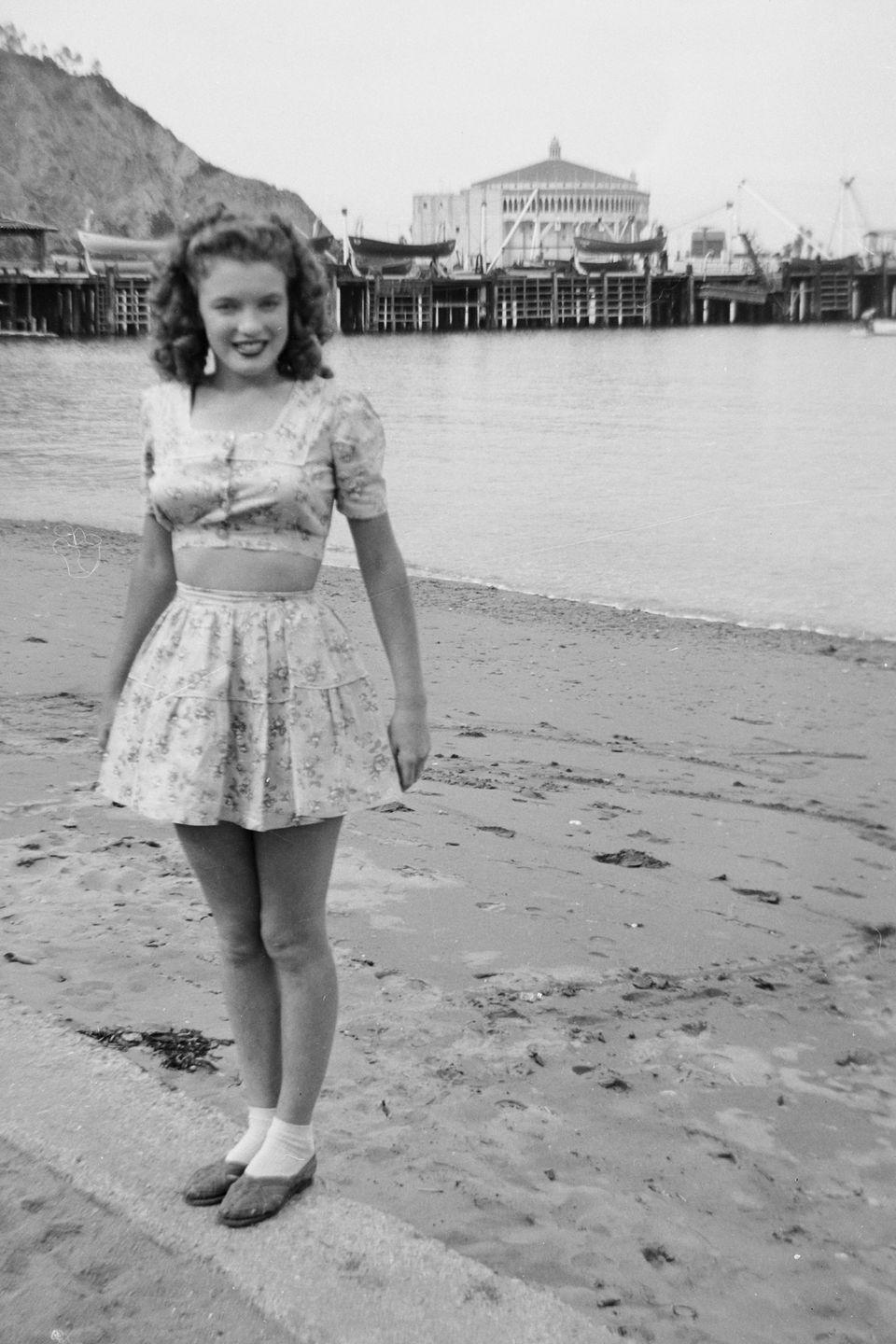 <p>Monroe on the beach at Santa Catalina Island with the Avalon Casino in the background. James was stationed on the island's boot camp, and the next year he was shipped out to the Pacific where he remained for two years. </p>