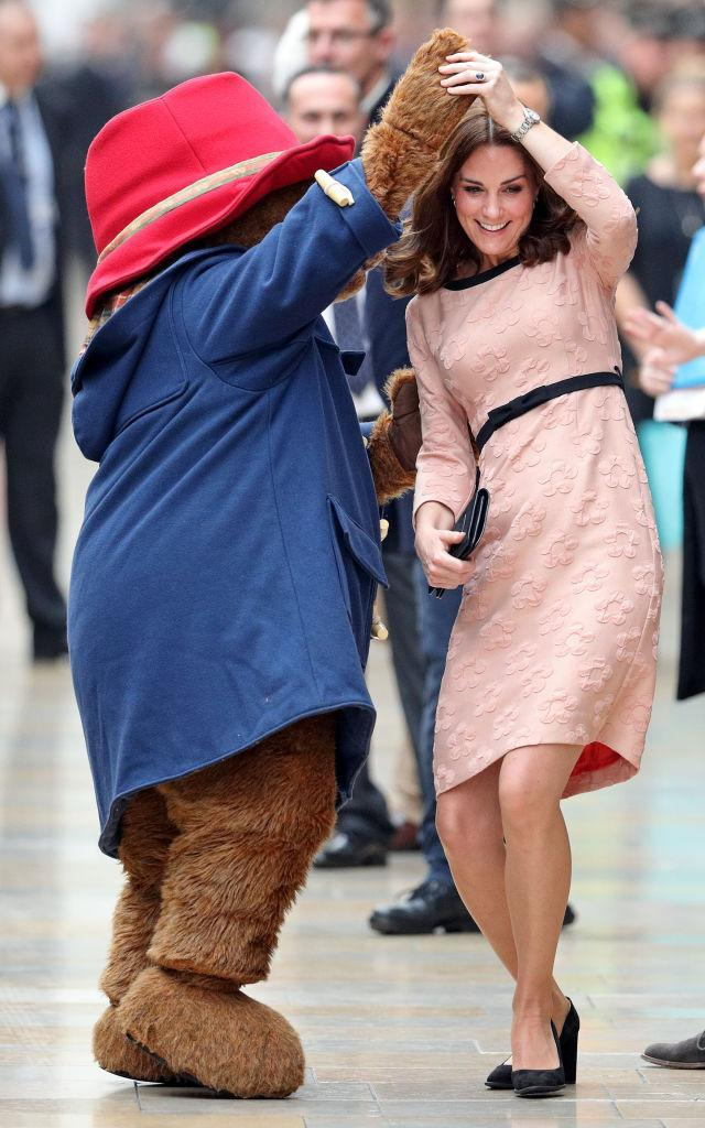 <p>On October 16, Kate donned a peach-hued lace dress by Orla Kiely to dance with Paddington Bear. <em>[Photo: Getty]</em> </p>