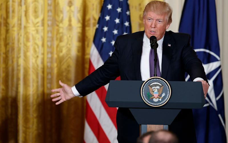 Donald Trump addresses a White House conference - AP