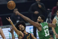 Boston Celtics' Tristan Thompson, right, and Cleveland Cavaliers' Jarrett Allen watch the ball during the first half of an NBA basketball game Wednesday, May 12, 2021, in Cleveland. (AP Photo/Tony Dejak)