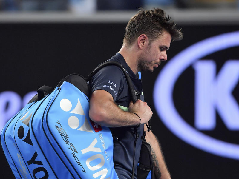 Switzerland's Stan Wawrinka walks from the court following his second round loss to United States' Tennys Sandgren at the Australian Open tennis championships in Melbourne, Australia, Thursday, Jan. 18, 2018. (AP Photo/Andy Brownbill)