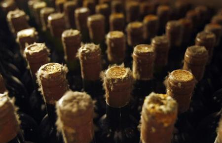 Mould-covered bottles of vintage wines are seen at the world's largest Cricova wine cellar, located outside Moldova's capital Chisinau