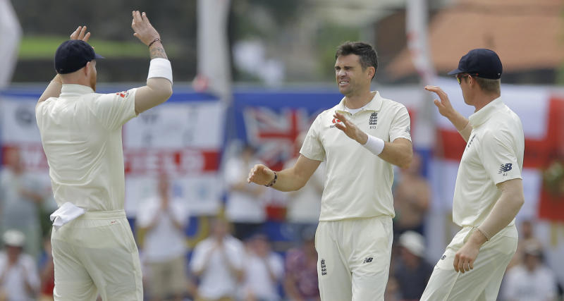 England's James Anderson, second right, celebrates taking the wicket of Sri Lanka's Dimuth Karunaratne with his team members during the second day of the first test cricket match between Sri Lanka and England in Galle, Sri Lanka, Wednesday, Nov. 7, 2018. (AP Photo/Eranga Jayawardena)