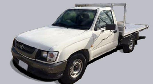 The car is described as being similar to a white 2001 Toyota Hilux single-cab, flat-tray utility. Source: Victoria Police