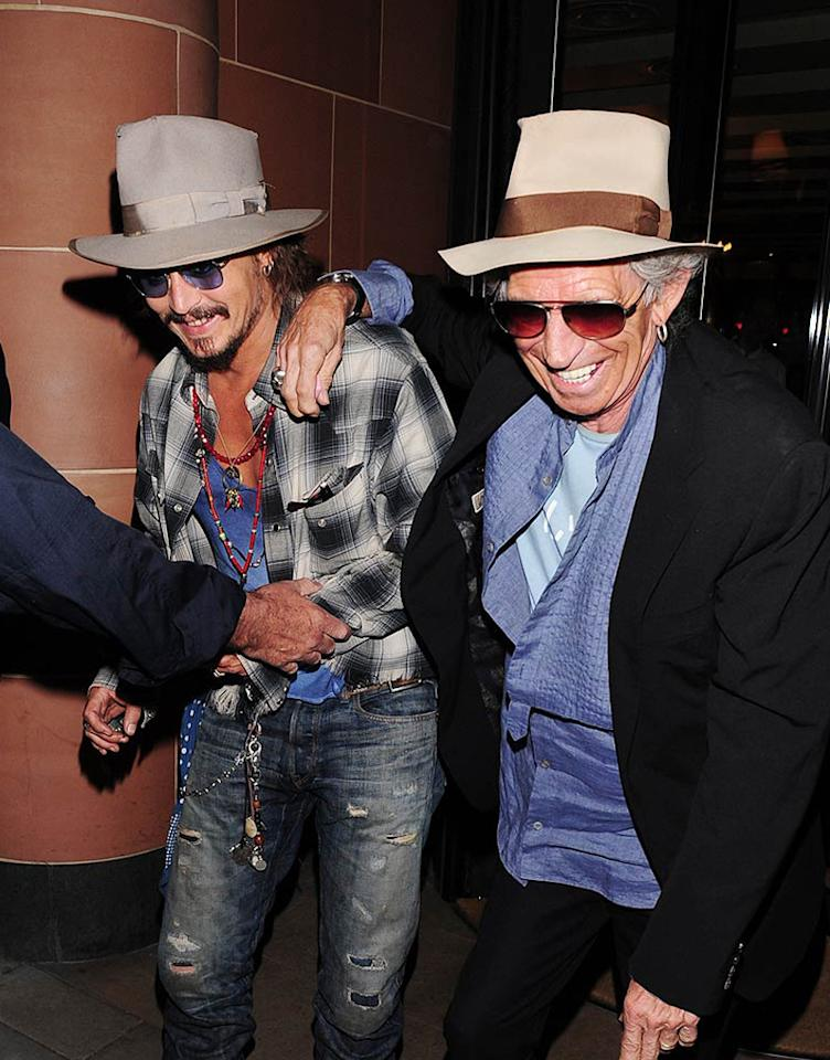 """Pirates of the Caribbean"" mates Johnny Depp and Keith Richards appeared to have had a smashing good time on the town as they exited C London restaurant in London. The usually hunky actor and his rocker pal, who play father and son in the saga on the high seas, looked uncannily alike during their off-camera outing. Tony Clark/<a href=""http://www.splashnewsonline.com"" target=""new"">Splash News</a> - September 15, 2010"