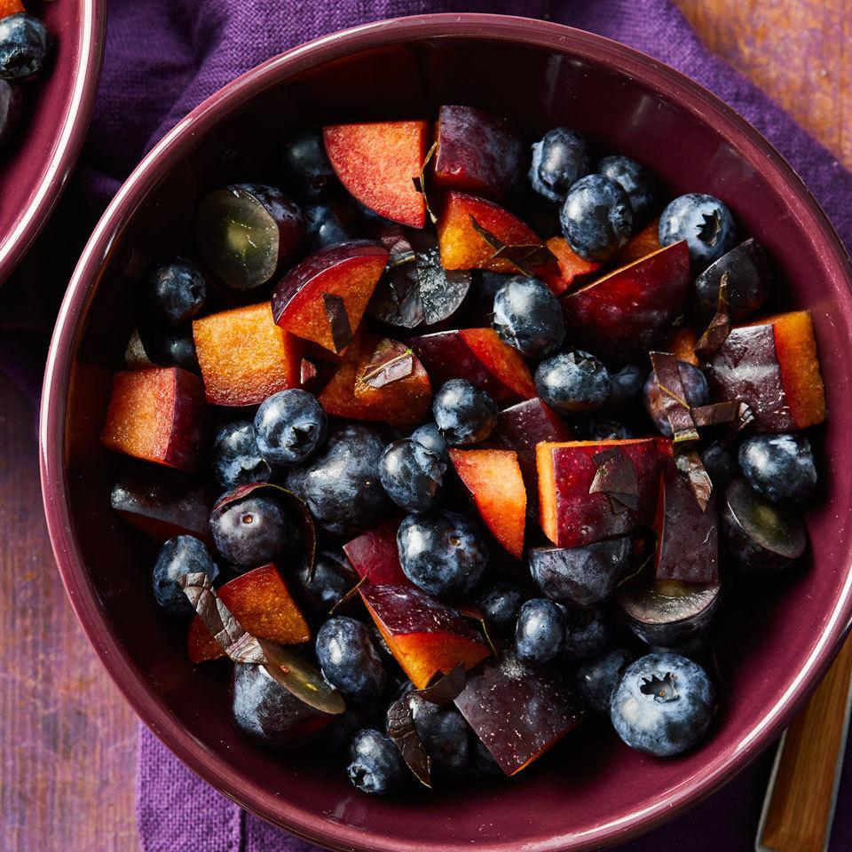 """<p>Serve this refreshing fruit salad featuring juicy plums, grapes and berries on its own or with other colorblock fruit salads (like red, green and orange) for a fun, crowd-pleasing rainbow side dish. <a href=""""http://www.eatingwell.com/recipe/258254/purple-fruit-salad/"""" rel=""""nofollow noopener"""" target=""""_blank"""" data-ylk=""""slk:View recipe"""" class=""""link rapid-noclick-resp""""> View recipe </a></p>"""