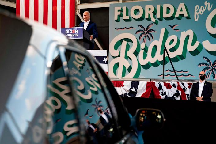 Democratic presidentia nominee Joe Biden speaks during a drive-in rally in Miramar, Florida on October 13, 2020. Biden is courting elderly Americans who helped elect President Donald Trump four years ago but appear to be swinging to the Democratic candidate this time.
