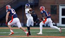 Northwestern wide receiver Miles Shuler, center, reaches back for a pass between Illinois linebacker Mason Monheim, left, and V'Angelo Bentley, right, during the first half of an NCAA college football game on Saturday, Nov. 30, 2013, in Champaign, Ill. (AP Photo/Jeff Haynes)
