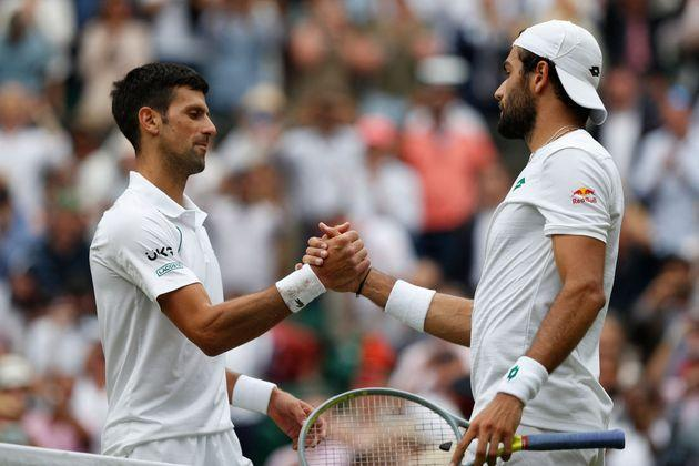 Serbia's Novak Djokovic (L) greets Italy's Matteo Berrettini after winning their men's singles final match on the thirteenth day of the 2021 Wimbledon Championships at The All England Tennis Club in Wimbledon, southwest London, on July 11, 2021. - RESTRICTED TO EDITORIAL USE (Photo by Adrian DENNIS / AFP) / RESTRICTED TO EDITORIAL USE (Photo by ADRIAN DENNIS/AFP via Getty Images) (Photo: ADRIAN DENNIS via Getty Images)