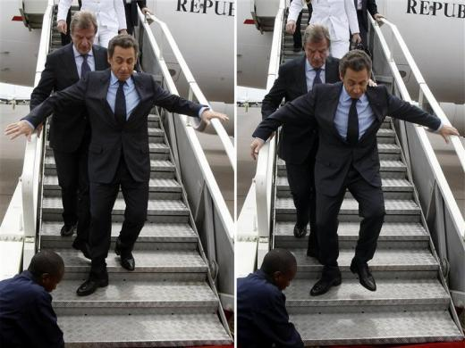 Two-way combo of France's President Nicolas Sarkozy helped by French Foreign Minister Bernard Kouchner (behind him) as he slips on his arrival at Kigali airport, February 25, 2010.