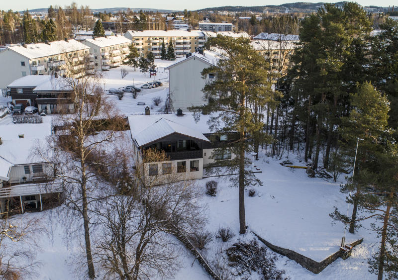 At centre a view of the home of Norwegian billionaire Tom Hagen and his wife Anne Elisabeth Falkevik Hagen in Fjellhamar Norway Wednesday Jan. 9 2019. Norwegian police say the missing wife of one of Norway's richest men has been abducted and