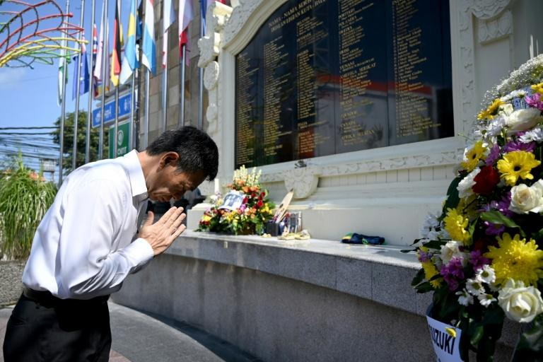 An official from the Japanese consulate was among diplomatic representatives and grieving families who paid respects and laid flowers at a memorial for victims of the 2002 Bali bombings, on the 17th anniversary of the attacks (AFP Photo/SONNY TUMBELAKA)