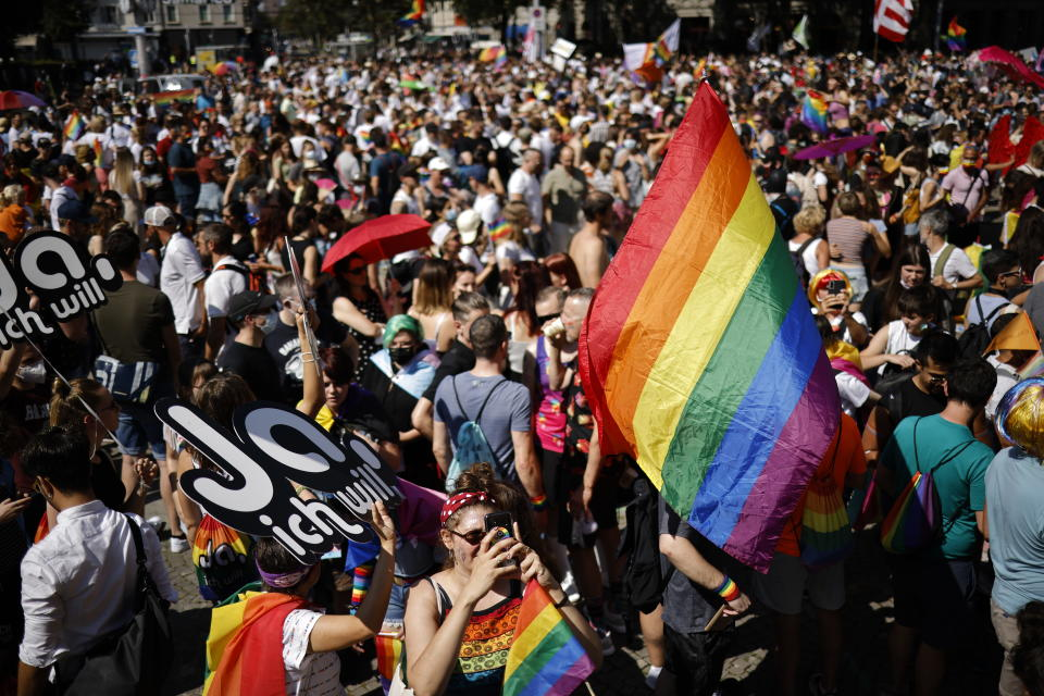 People gather for the Zurich Pride parade in Zurich, Switzerland, Saturday, Sept. 4, 2021. On Sept. 26, 2021 Swiss citizens will vote on the proposal of 'Marriage for everyone' (Ehe fuer alle), allowing marriage for same-sex couples. (Michael Buholzer/Keystone via AP)