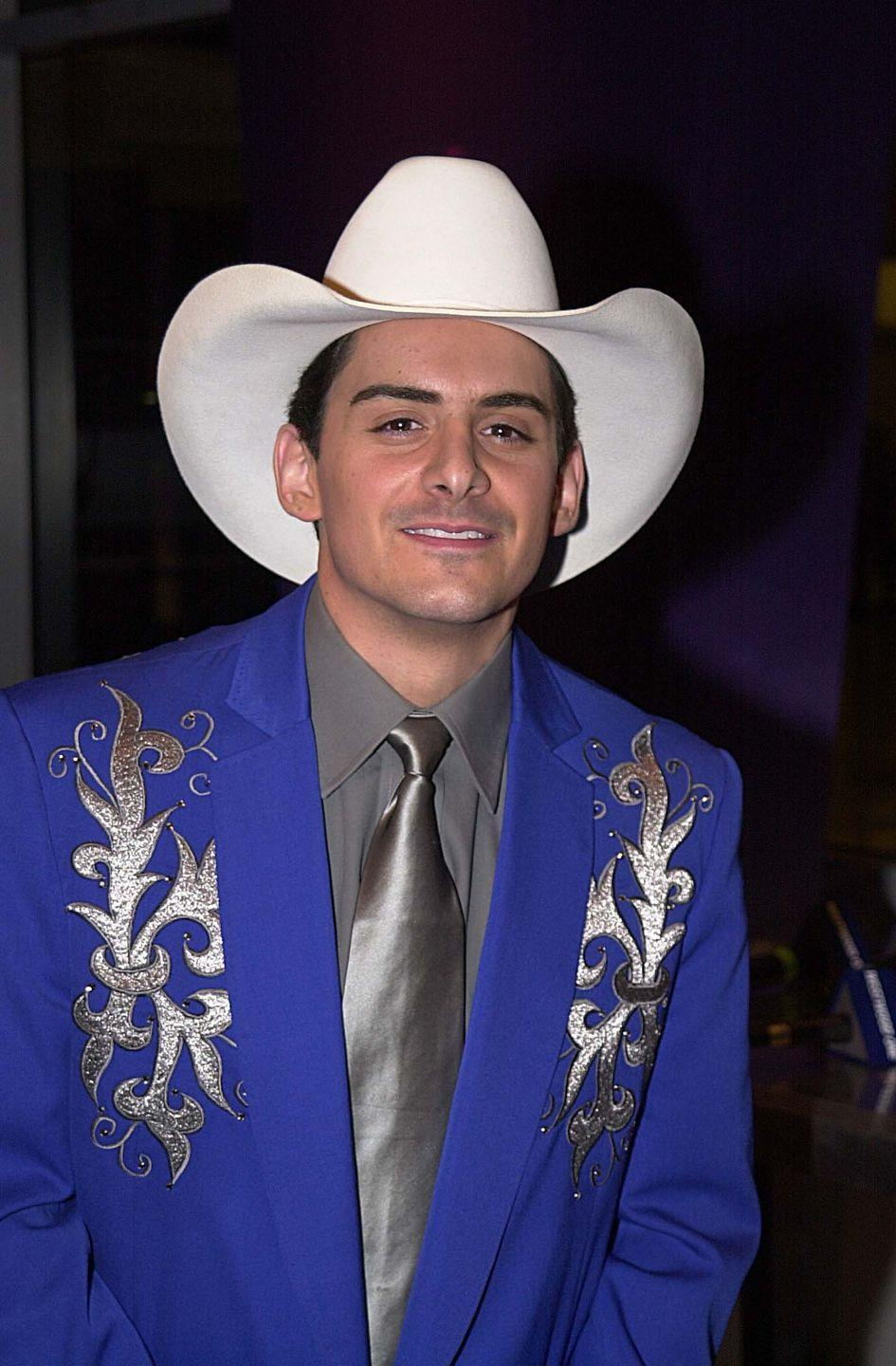<p>Yee-<em>freaking</em>-HAW to Brad's embroidered blue blazer and silver metallic tie. Like <em>Westworld</em> but more technicolor-y.</p>