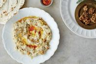 """This is a wonderful Iranian dip with a subtle flavor of caramelized onion and saffron and a silky texture offset by the lovely crunch of the walnut garnish. <a href=""""https://www.epicurious.com/recipes/food/views/iranian-eggplant-and-labneh-yogurt-spread-borani-e-badenjan?mbid=synd_yahoo_rss"""" rel=""""nofollow noopener"""" target=""""_blank"""" data-ylk=""""slk:See recipe."""" class=""""link rapid-noclick-resp"""">See recipe.</a>"""