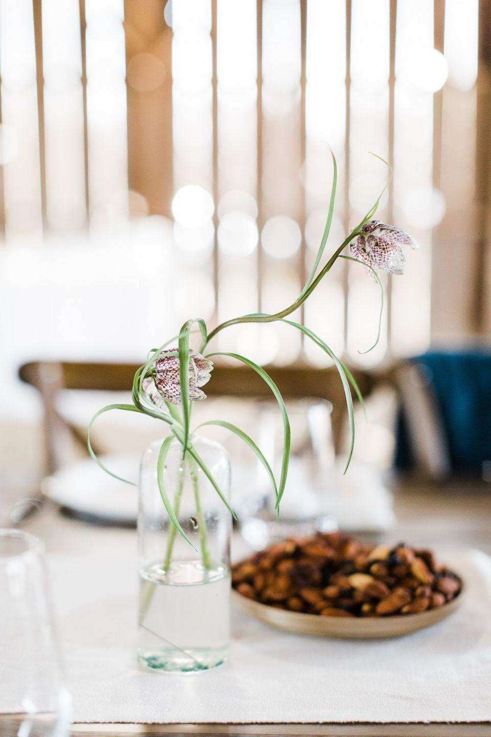 <p>For a clean, minimalist tablescape, opt for single stems in narrow, slim vases. Choose your favorite flowers to display for a personalized Easter brunch floral arrangement. </p>