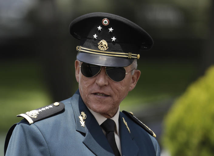 FILE - In this Sept. 14, 2016 file photo, Secretary of Defense Salvador Cienfuegos Zepeda arrives for a review of the troops that will participate in the Independence Day parade, in Mexico City. Mexican prosecutors on Thursday, Jan. 14, 2021, declared completely unfounded the U.S. case against Cienfuegos who was arrested on drug charges in the United States and then returned under pressure from the Mexican government. (AP Photo/Rebecca Blackwell, File)