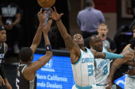 Charlotte Hornets guard Terry Rozier (3) attempts to block a shot by Sacramento Kings guard De'Aaron Fox (5) during the first quarter of an NBA basketball game in Sacramento, Calif., Sunday, Feb. 28, 2021. (AP Photo/Randall Benton)