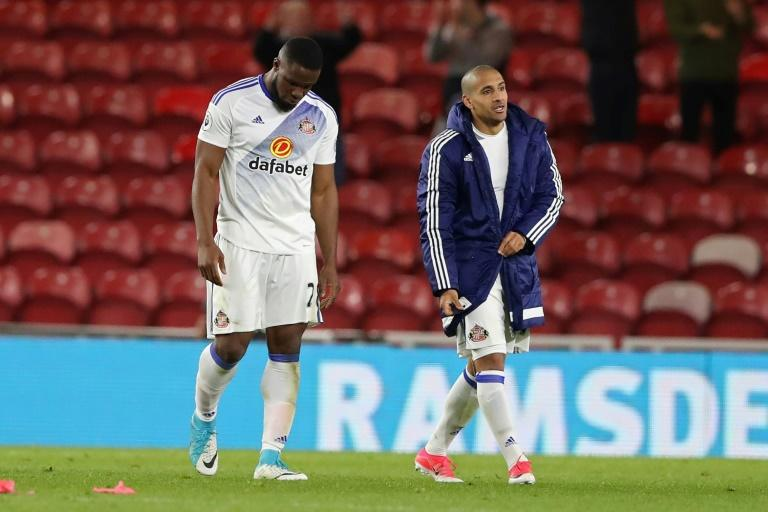 Sunderland's striker Victor Anichebe (L) and Sunderland's midfielder Wahbi Khazri walk from the picth after the English Premier League football match against Middlesbrough April 26, 2017