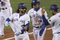 Toronto Blue Jays Bo Bichette celebrates his three-run homer with teammates against Tampa Bay Rays pitcher Aaron Loup during the sixth inning of a baseball game, Friday, Aug. 14, 2020, in Buffalo, N.Y. (AP Photo/Jeffrey T. Barnes)