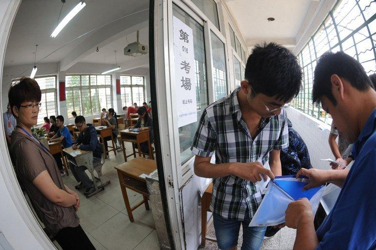 A student gets his belongings searched before taking the tough college entrance exams in Bozhou, China, June 7, 2012