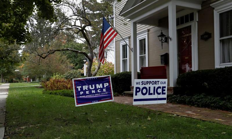 A home bears signs supporting Donald Trump.