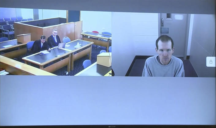This image made from a video, shows Brenton Harrison Tarrant, right, and lawyers in a screen via video link in Christchurch, New Zealand Thursday, March 26, 2020. One year after killing 51 worshipers at two Christchurch mosques, Tarrant, an Australian white supremacist accused of the slaughter has changed his plea to guilty. (TVNZ Pool via AP)